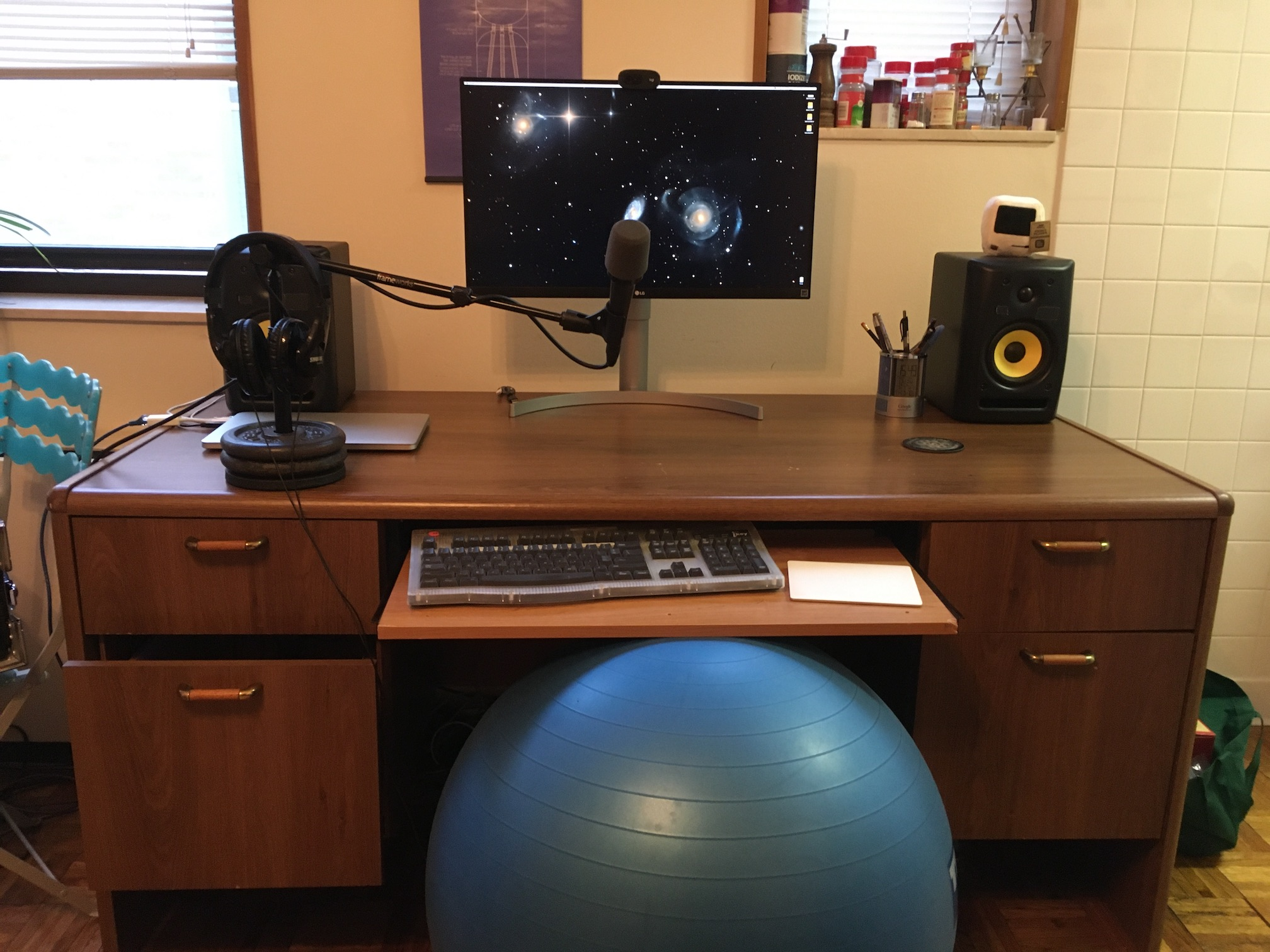 desk with mic, headphones, and speakers